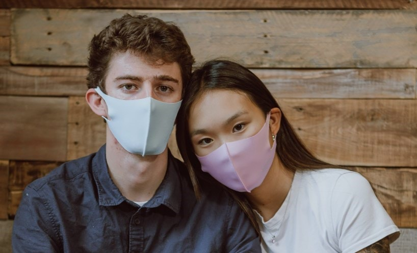 a couple wearing face masks