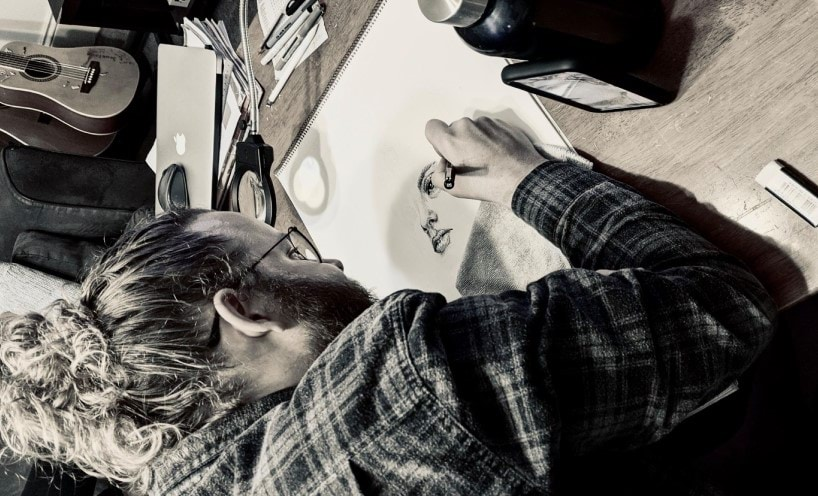 Melbourne-based freelance artist Hingrito, in his element drawing a woman's face by hand.