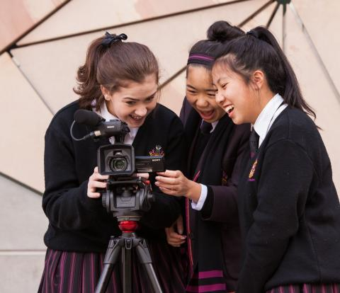 ACMI Film it group looking into camera
